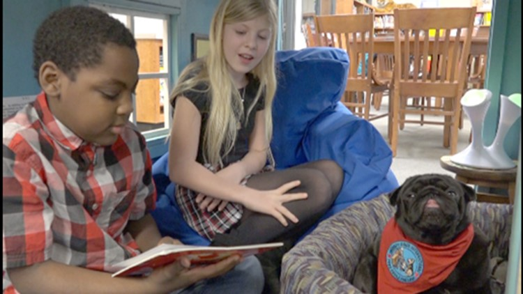 Booker T Pug reads with students