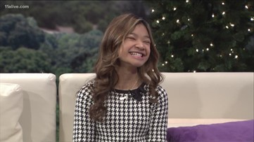Angelica Hale belts out 'Santa Claus is Coming to Town' during halftime of Atlanta Falcons game