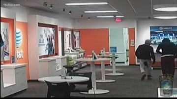 Masked men rob Conyers AT&T store