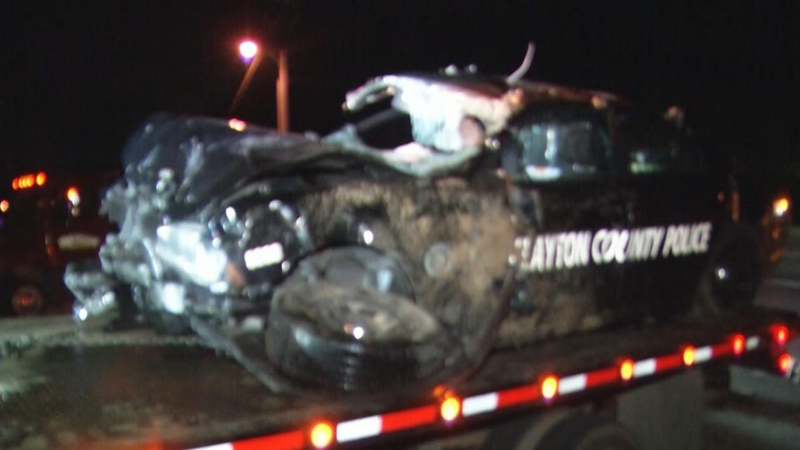 Clayton County officer extricated from car after crash