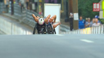Manuela Schar wins women's wheelchair division of the AJC Peachtree Road Race by setting record
