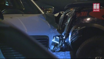 Woman arrested for DUI after collision with police car