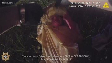 Video shows moment newborn pulled from plastic bag in woods