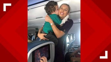 Delta flight attendant  soothes autistic child during rough flight