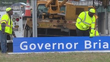GDOT crews change out 'Welcome to Georgia' signs to add Gov. Brian Kemp's name