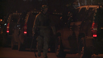 SWAT team rescues children out of home; armed man gets away