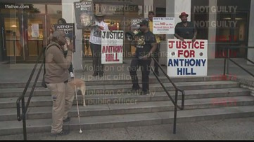 Demonstrators rally outside courthouse after Robert Olsen convicted in Anthony Hill shooting
