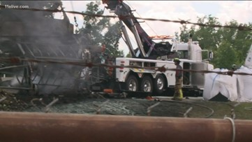 Truck driver charged in fiery crash that killed four in Henry County