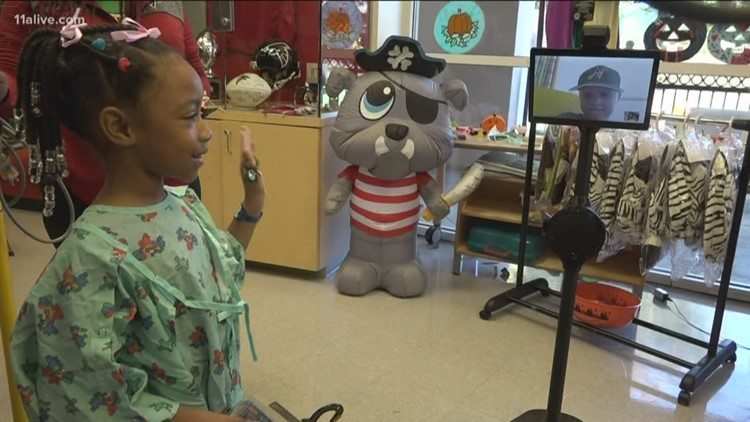 Robots at the Children's Healthcare of Atlanta help to transport the fun to kids who may not be able to leave their room