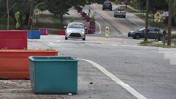 Driving hazard or pedestrian protection? Decatur planters stir passionate debate