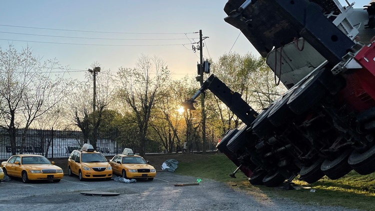 Photos: Crane collapses on roof of building
