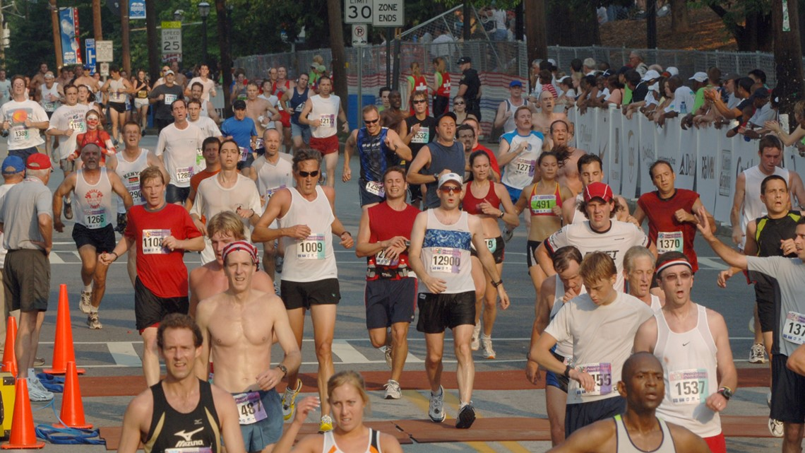 Why is the AJC Peachtree Road Race a 10,000-meter event?