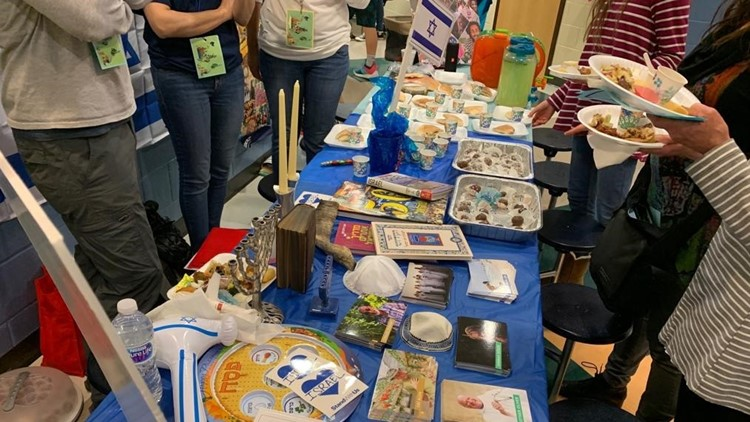 Israel table at middle school multicultural event