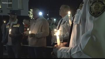 Hundreds attend vigil for slain former assistant police chief in Covington