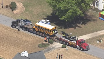 Bus with students on board crashes, flips in Coweta