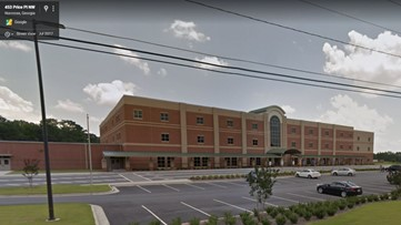 Threat written on bathroom wall prompts investigation at Gwinnett middle school
