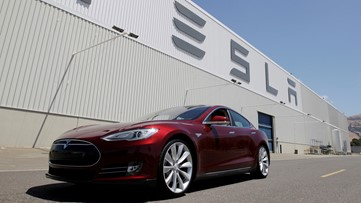 Fire at Tesla plant under control, officials say