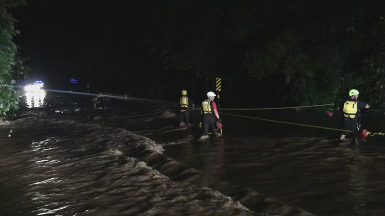 Gwinnett firefighters rescue 2 people from vehicle that became submerged by flash floods