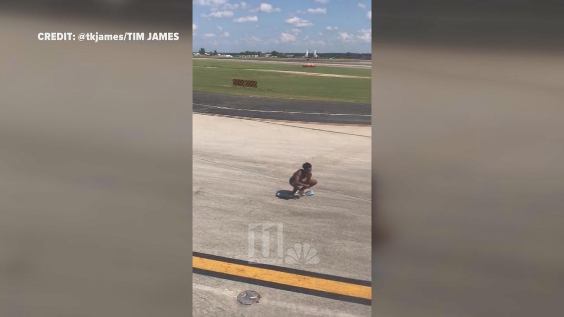 Delta flight interrupted after half-naked man runs onto