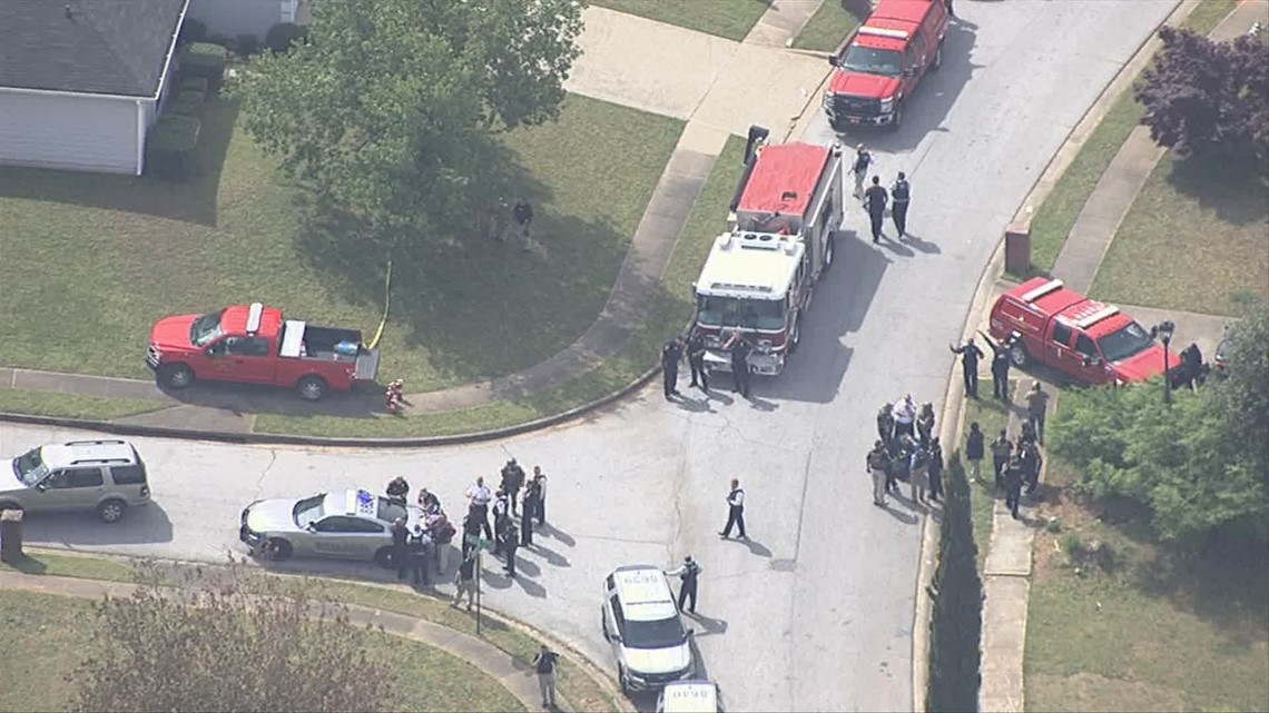 Pregnant woman, teen found dead after standoff at home where