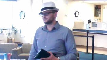 Fedora-wearing bank robber demands cash, gets away in Carrollton