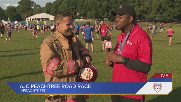 Marietta firefighter runs AJC Peachtree Road Race in his gear!
