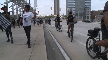 Protesters take to 17th Street bridge, call out police brutality