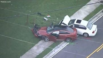 Authorities investigate two-car crash in Johns Creek