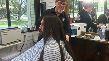Fayetteville man grows 6 feet of hair over 12 years to help children