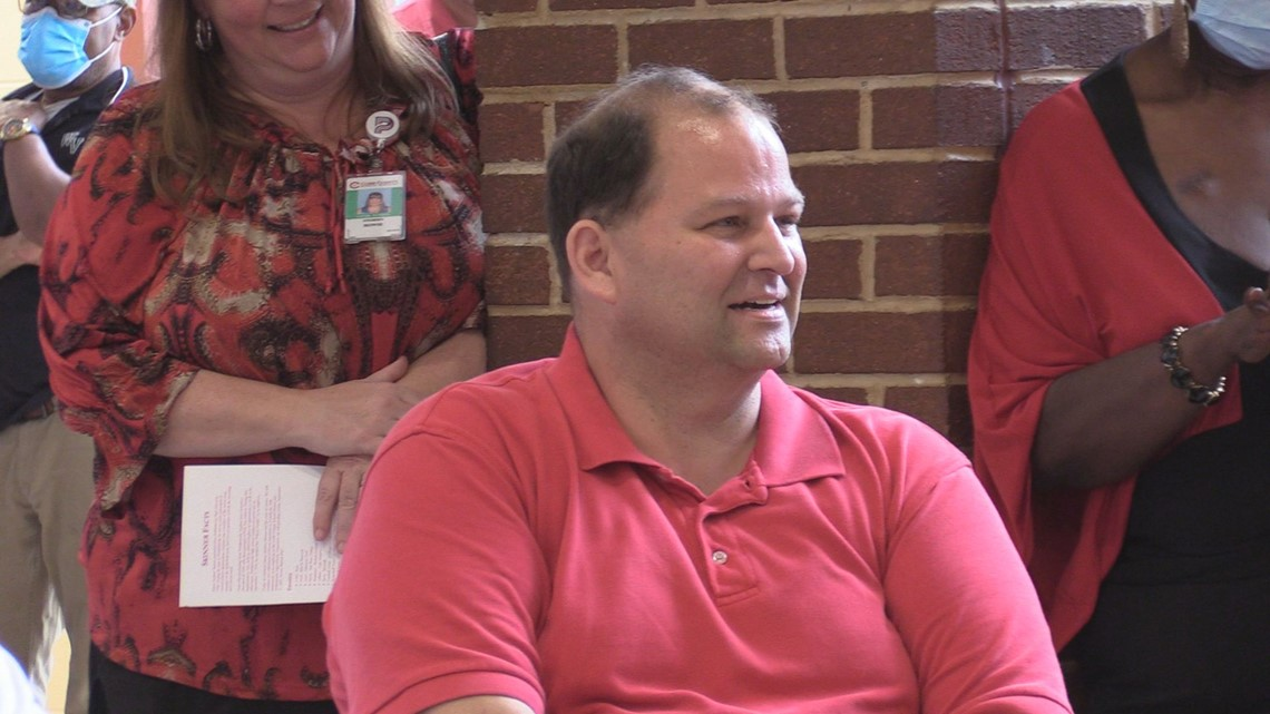 Cobb high school celebrates custodian who has worked there for 30 years