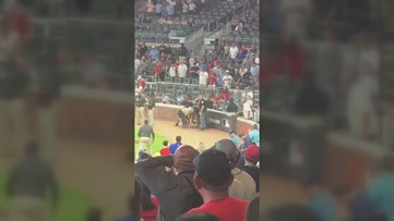 Braves fan tackled after running onto the field during game