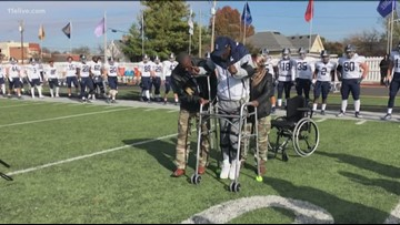 College football player with paralyzing injury walks on field