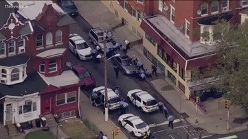 Gunman wounds at least 6 Philadelphia police officers; 2 others freed in 8-hour standoff