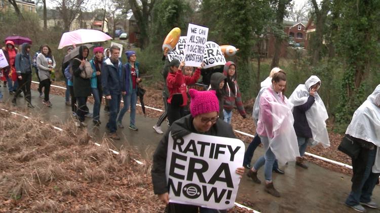 Women's March draws dozens in Atlanta despite rain, cold