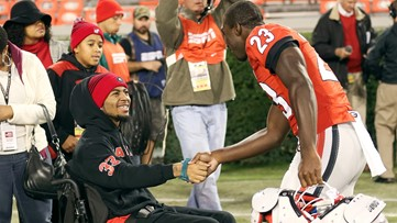 Paralyzed college player returns to football as assistant coach for Atlanta-area high school