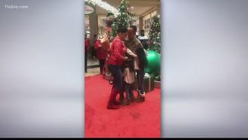 Army sergeant surprises wife, daughters at metro Atlanta mall
