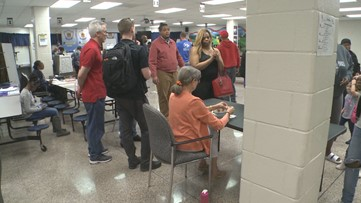 Gwinnett Co. voters wait for hours after workers forget power cords for the voting machines