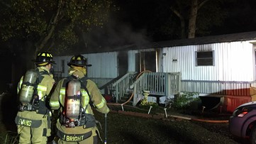 Three people escape burning mobile home, but dog perishes