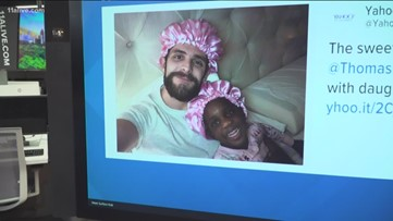 Country singer wears pink bonnet to match his daughter