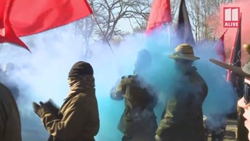 RAW: Stone Mountain counter-demonstrators march through streets
