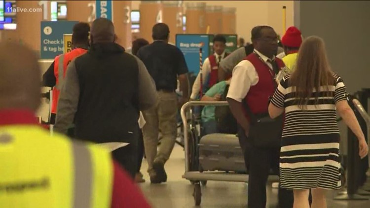 Airport wait times not as bad Tuesday morning, but travelers beware