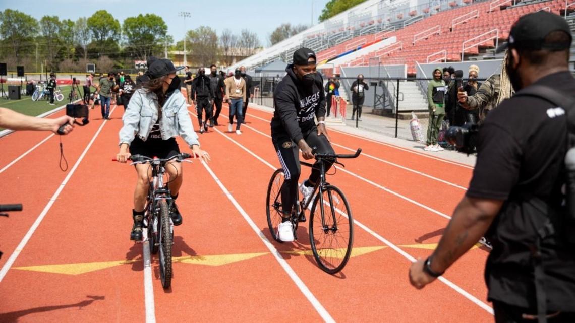 Jeezy, Jeannie Mai partner with Tony Robbins to gift bicycles to Atlanta youth