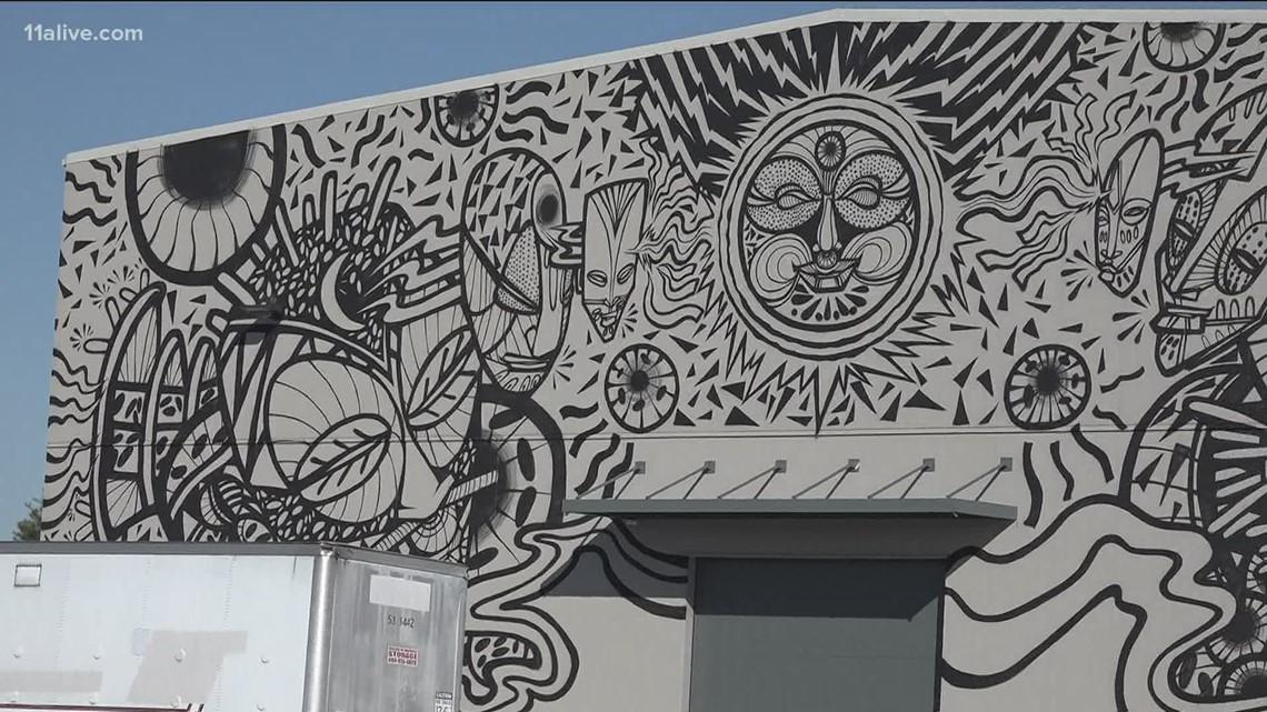 Black Panther artist creates huge mural at Pinewood
