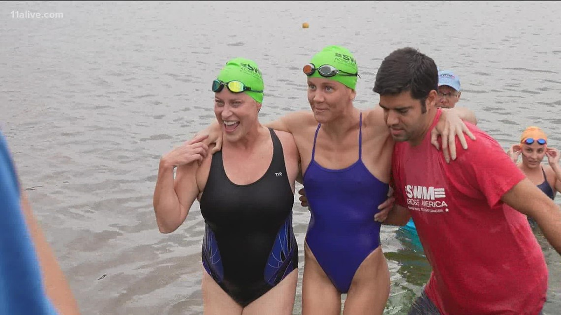 Mom swims 14 miles to honor daughter