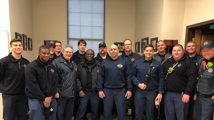 LFD Firefighter Pete Trujillo poses with coworkers on his first day back to work