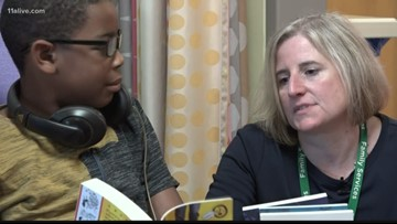 Mother whose son had surgeries gives back time through hospital library