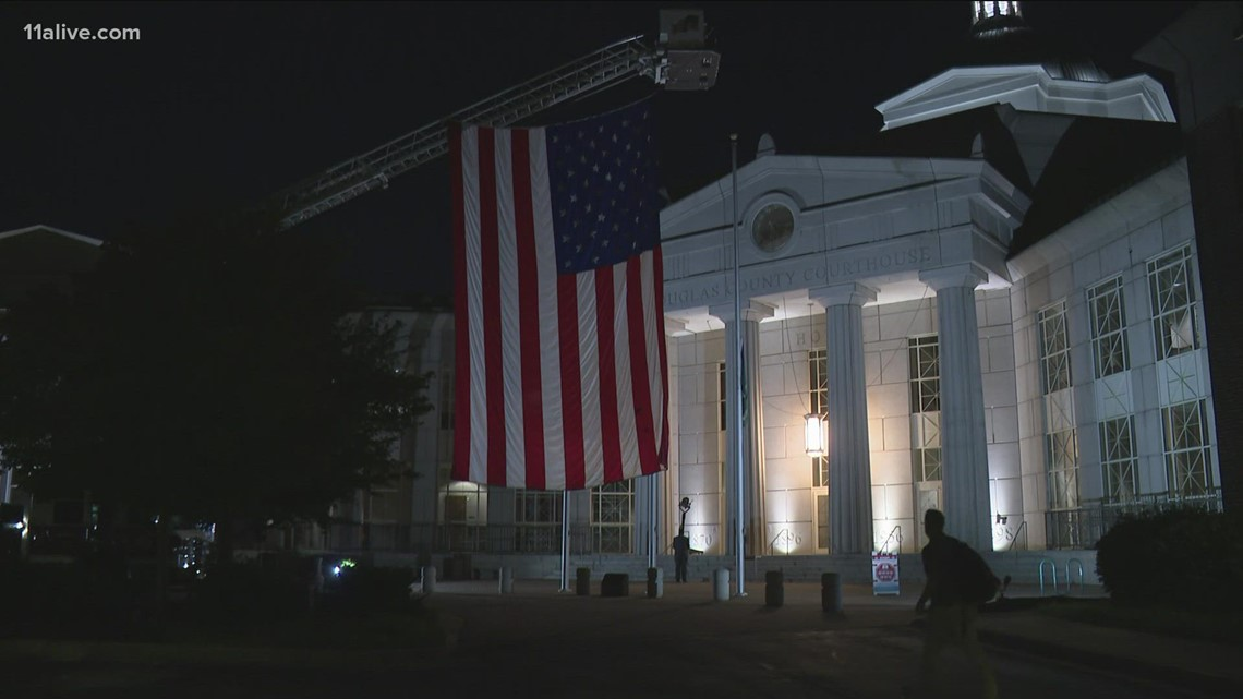 Douglas County drapes 100-foot flag in front of courthouse to mark 9/11