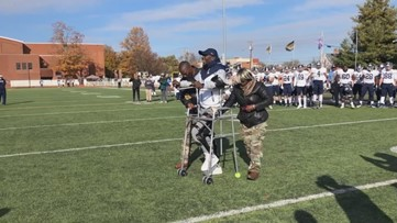 College football player Justus Edwards walks back to spot where he was critically injured