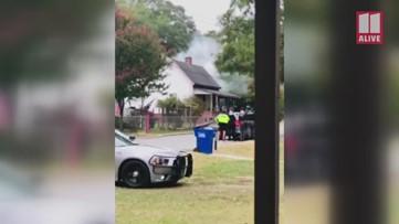 Scene video: SWAT crews, deputies and officers wait outside during tense standoff