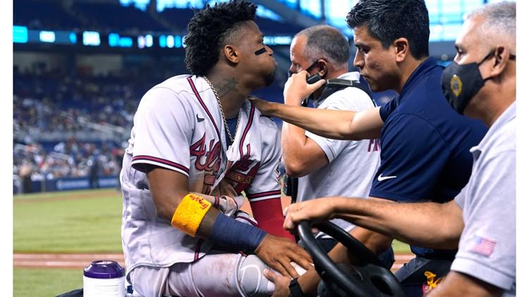 Braves star Acuña tears ACL | PHOTOS